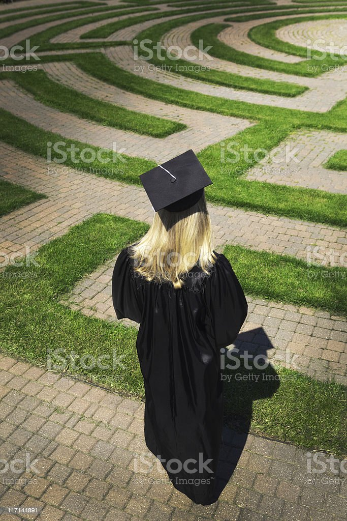 Graduating Student Facing Puzzling Maze to Their Future Path stock photo