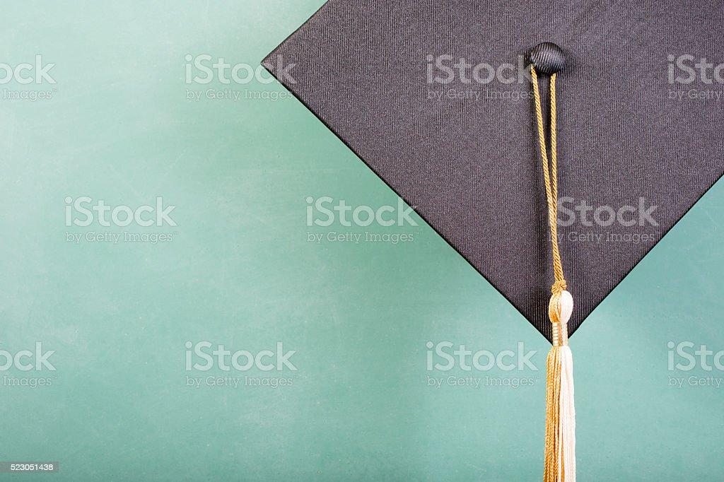 Graduation!  Cap, motarboard, green chalkboard. Education background. stock photo