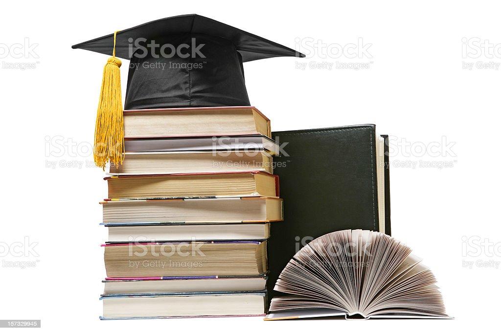 Graduation cap on books royalty-free stock photo
