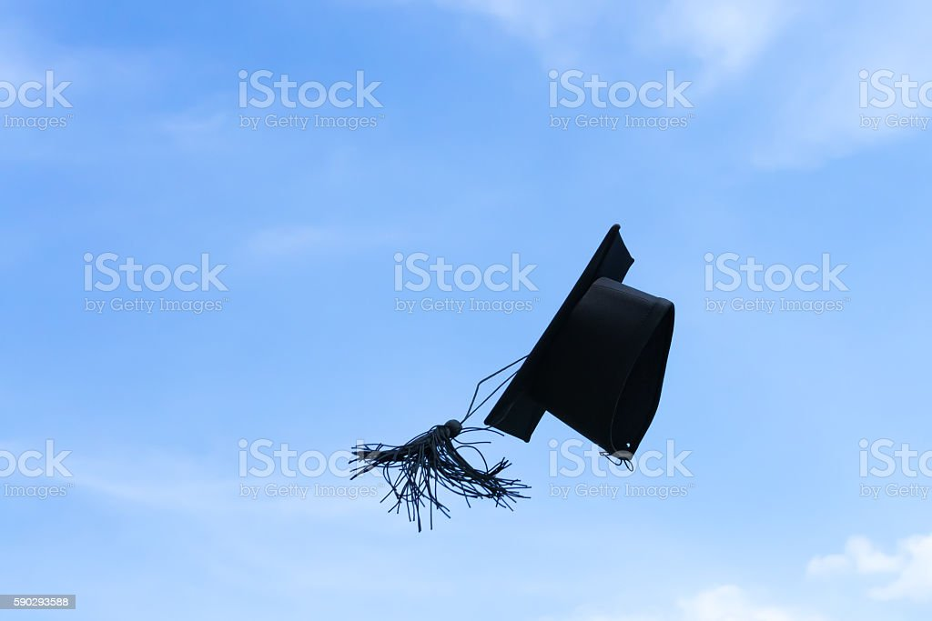 Graduation cap or mortar board thrown up to the sky stock photo