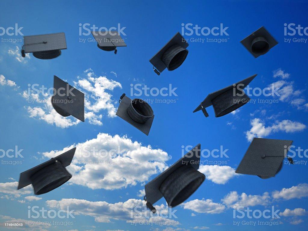 Graduation caps stock photo
