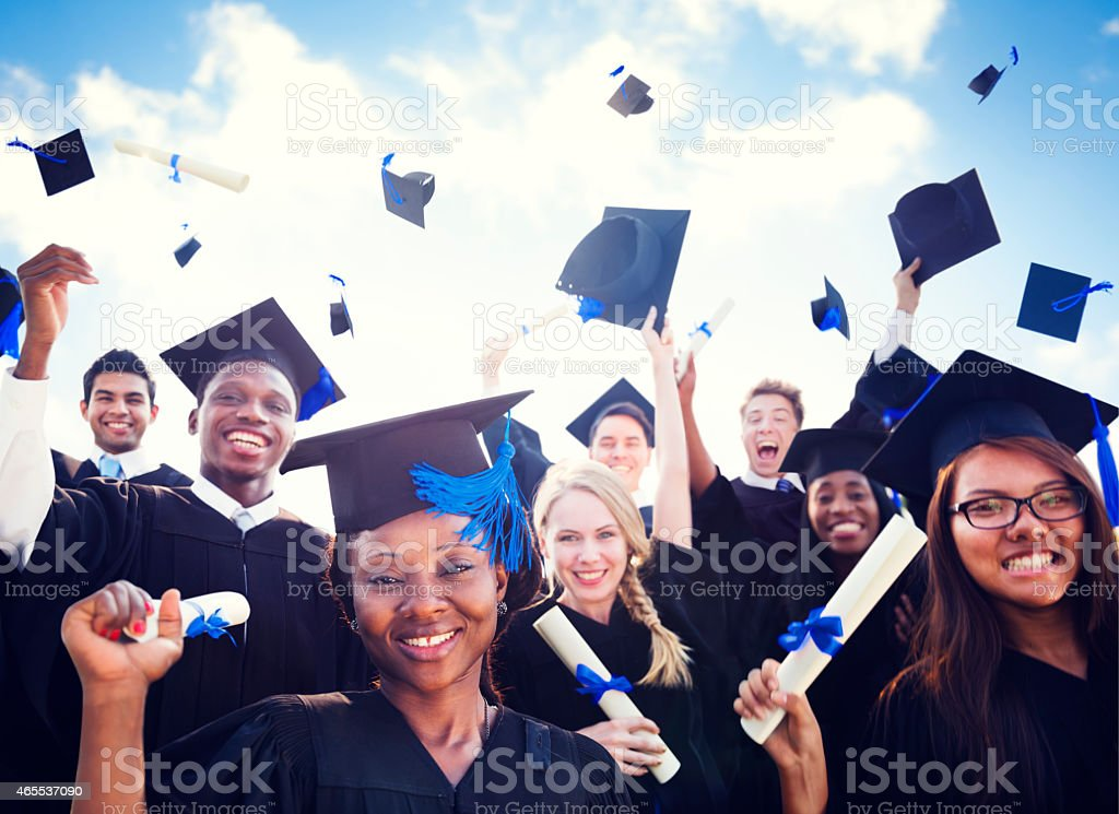 Graduation Caps Throwing Air Concept stock photo