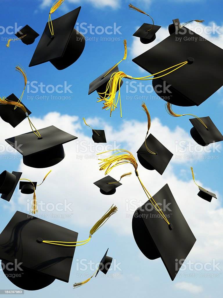 Graduation caps thrown in the air royalty-free stock photo