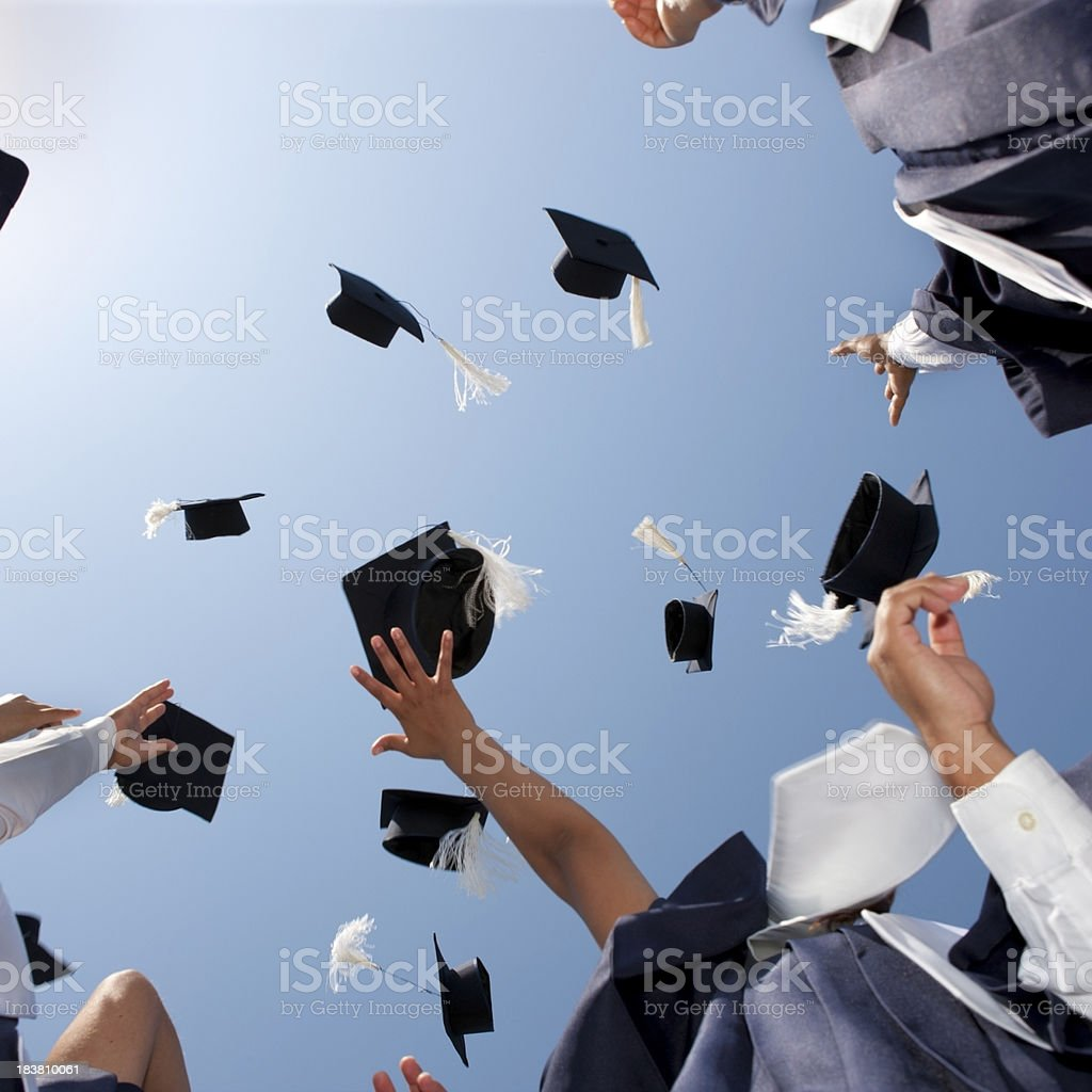 Graduation Caps Thrown in the Sky stock photo