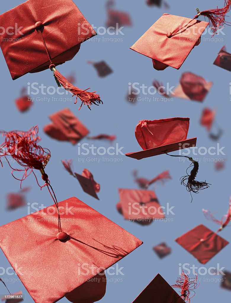 Graduation Caps with motion blur royalty-free stock photo