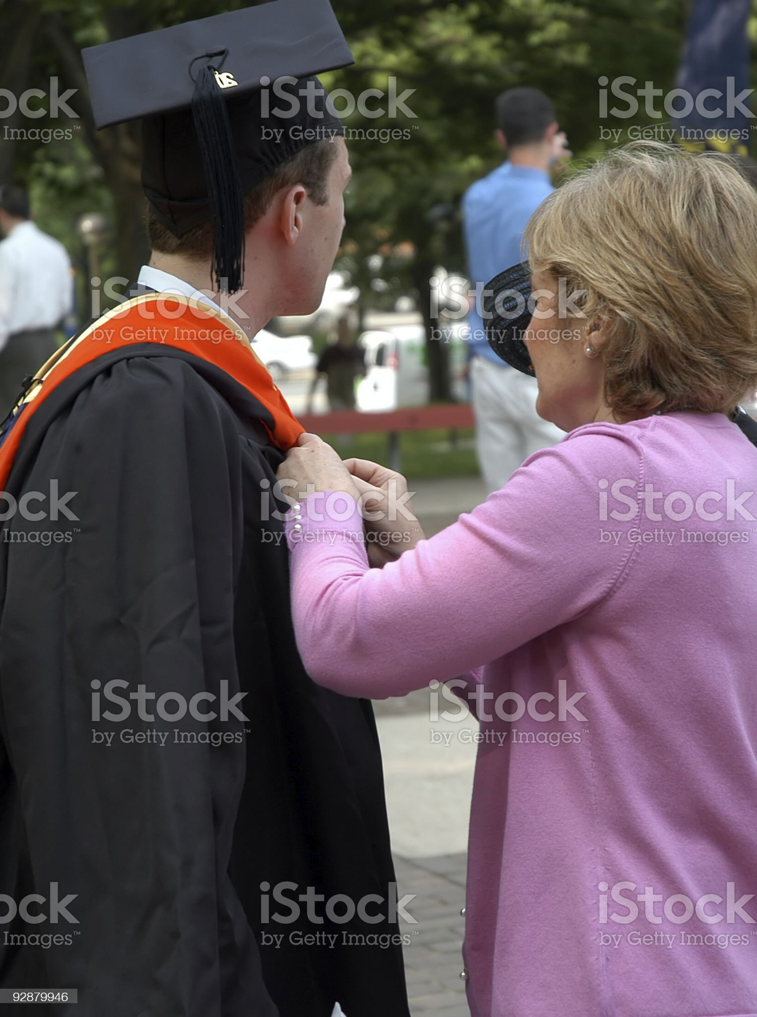 Graduation day assistance from mom royalty-free stock photo