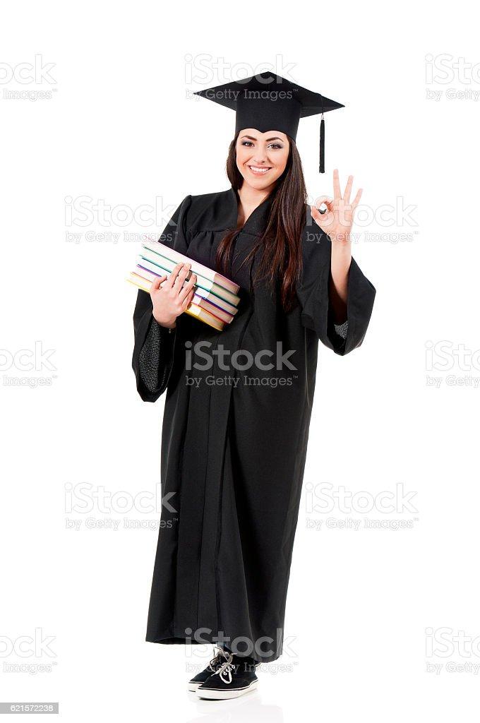 Graduation female student holding books stock photo