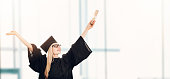 graduation - happy student in gown with diploma