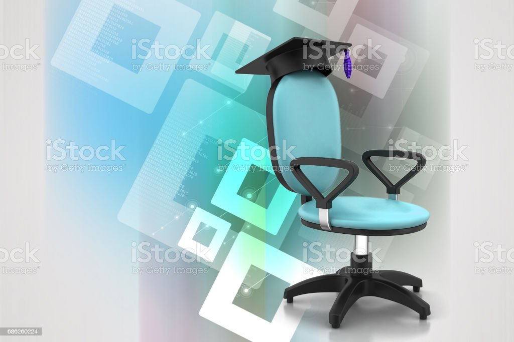 graduation hat in office chair stock photo