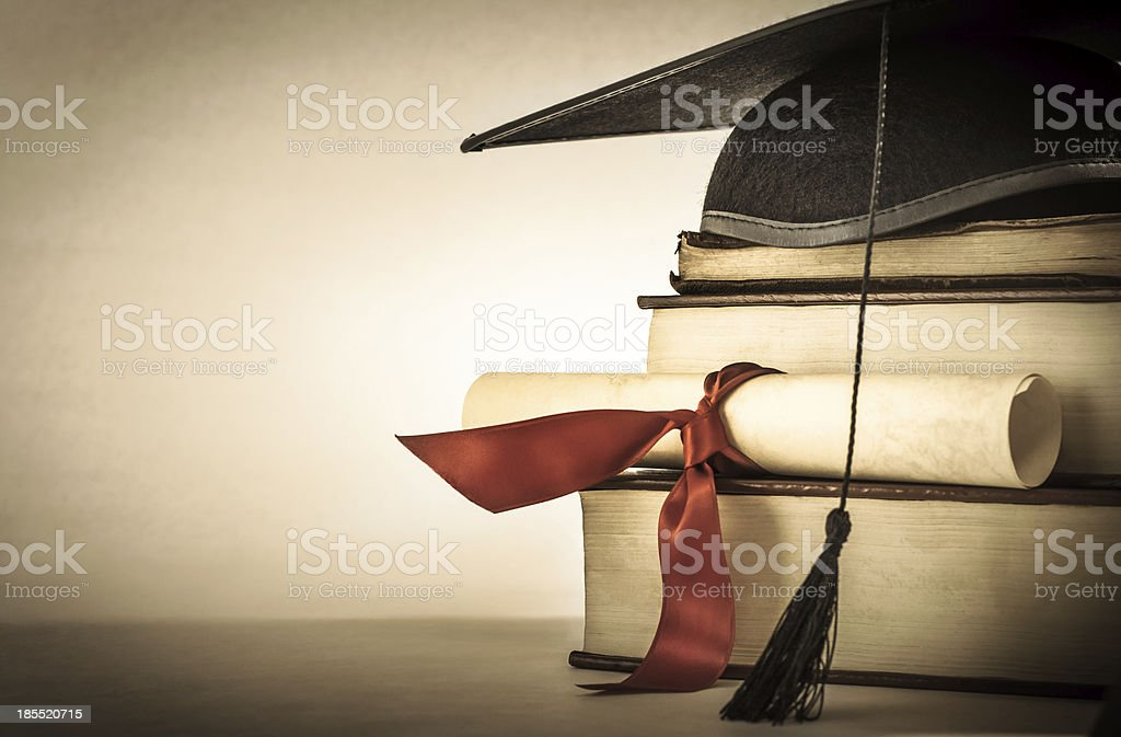 Graduation Scroll and Book Stack stock photo