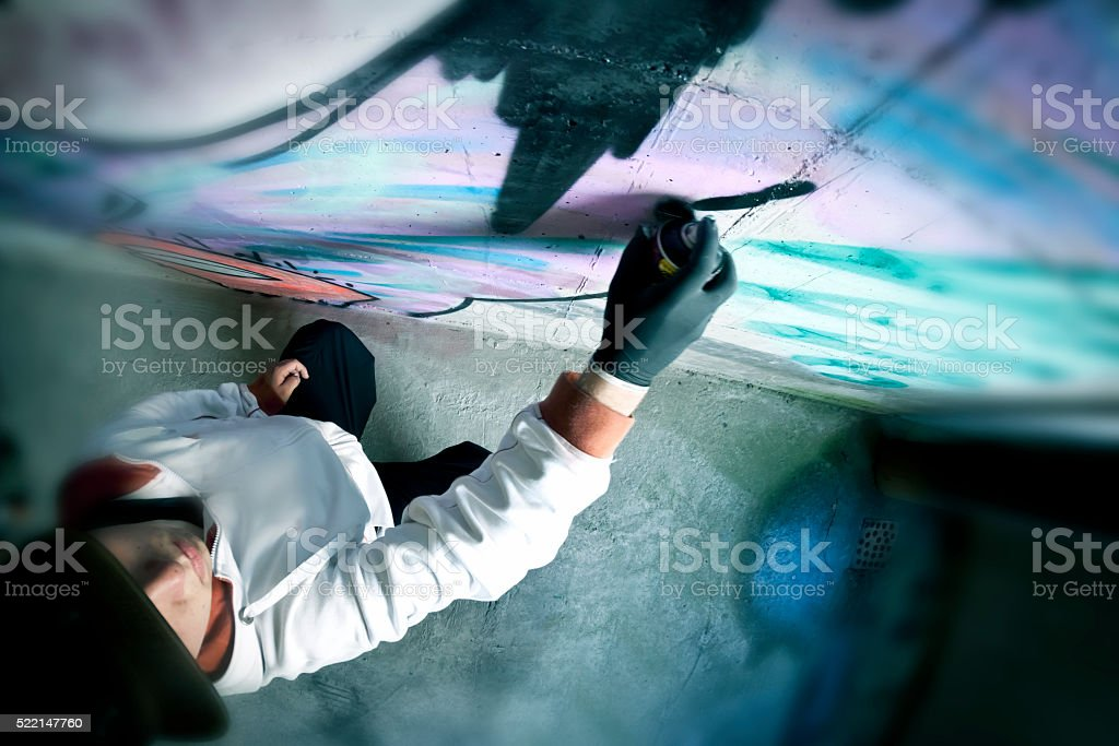 Graffiti artist at work, high angle view stock photo