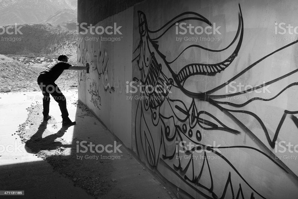 Graffiti Artist in Tunnel stock photo