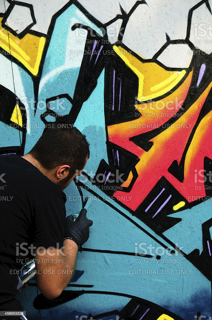 Graffiti artist is working royalty-free stock photo