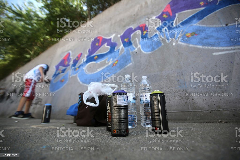 Graffiti artist painting stock photo