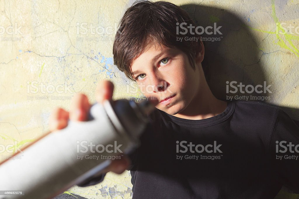 Graffiti Boy - Pointing Can of Paint royalty-free stock photo