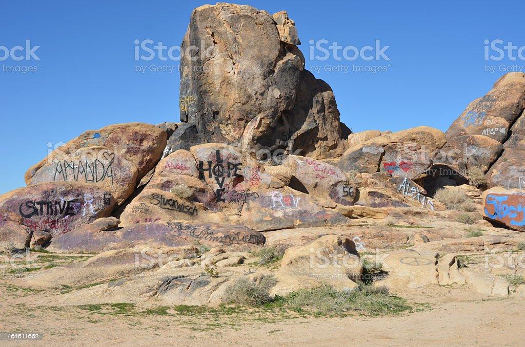Graffiti Covered Boulders in California Desert royalty-free stock photo
