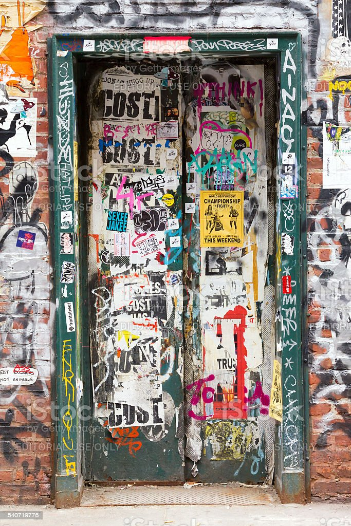 Graffiti covered doorway in New York City stock photo
