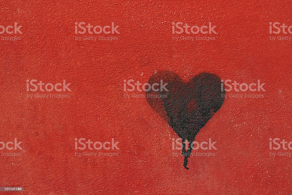 Graffiti heart spraypainted on red wall - Love Concept royalty-free stock photo