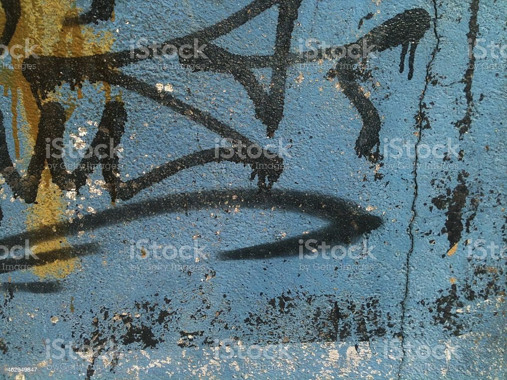 Graffiti on a blue wall stock photo