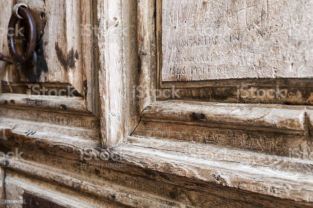 Graffiti on Church of Holy Sepulchre door royalty-free stock photo