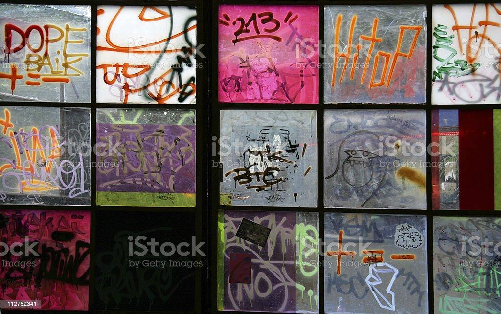 Graffiti on windows in Berlin Germany (Series) stock photo