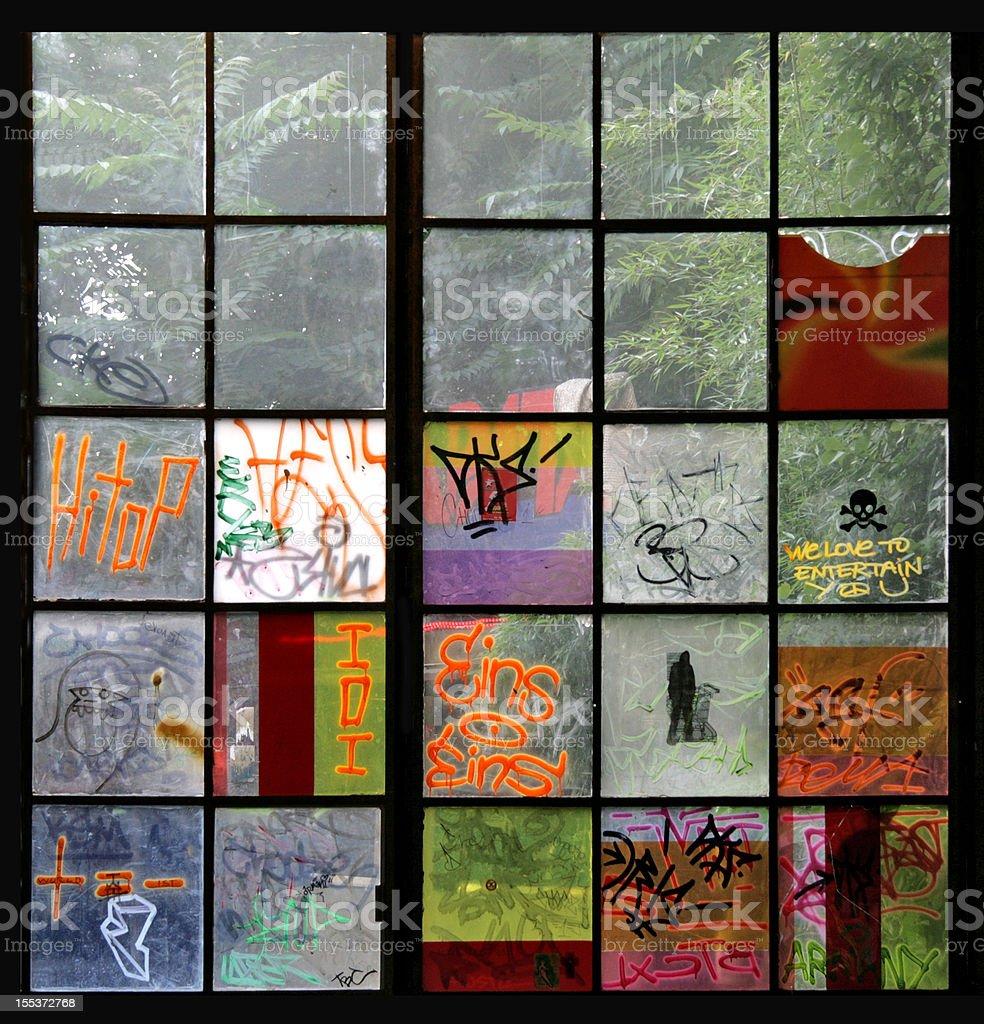 Graffiti on windows  in Berlin (Series) stock photo