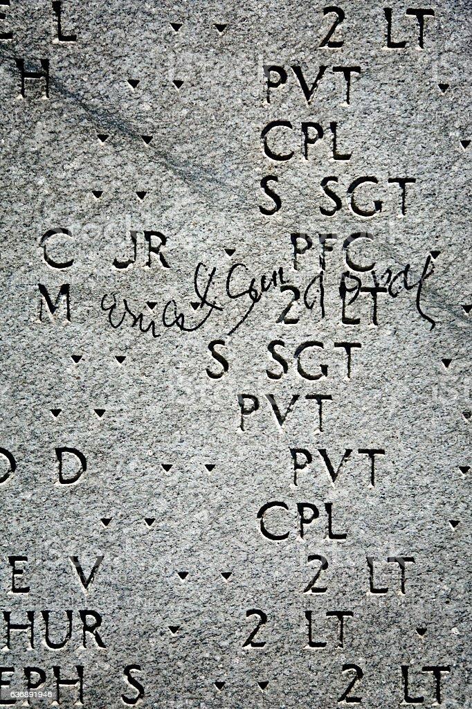Graffiti on WWII East Coast Memorial, Battery Park, Lower Manhattan stock photo