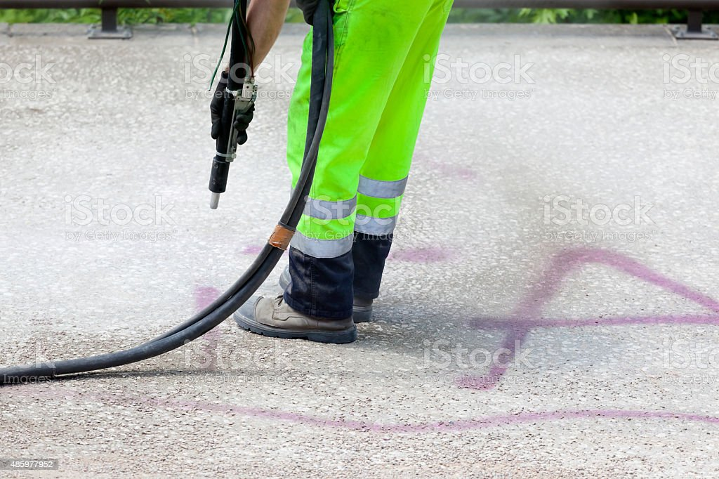 Graffiti Removal by Dustless Blasting stock photo