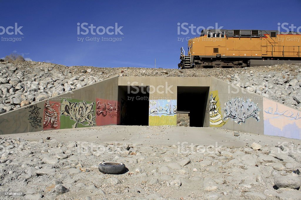 Graffiti Storm Drain with Train stock photo