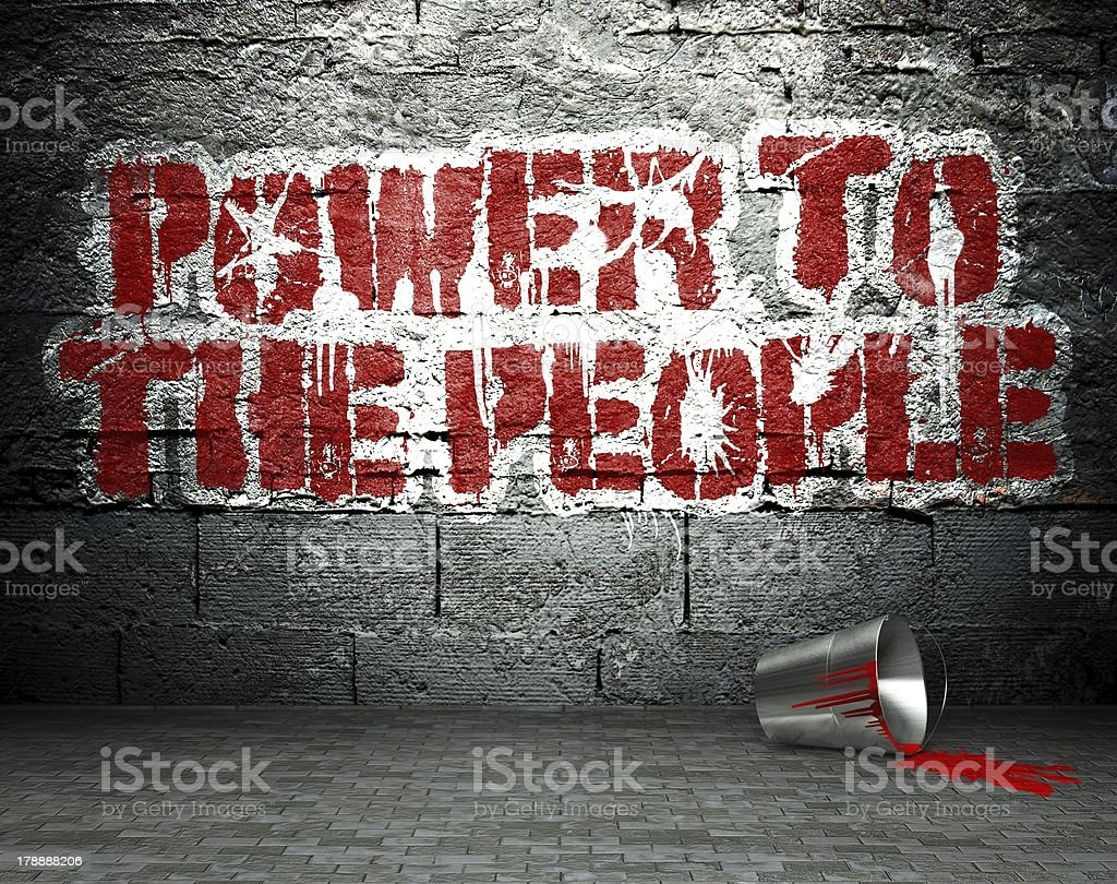 Graffiti wall with power to the people, street background royalty-free stock photo