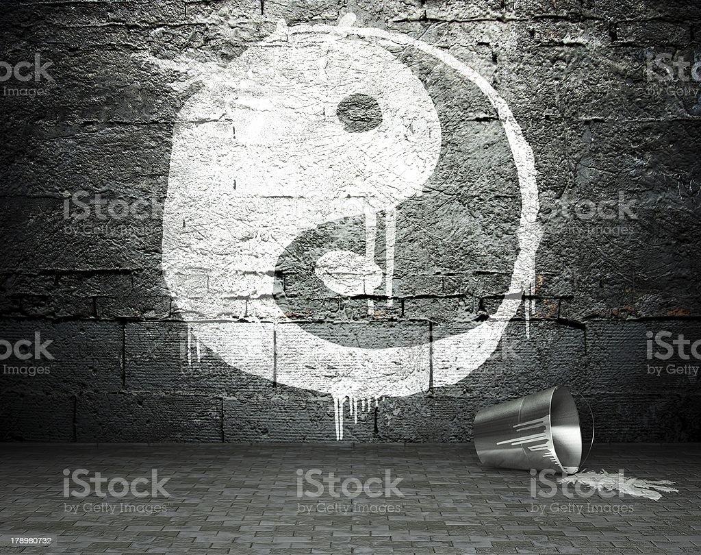 Graffiti wall with yin yang, street background royalty-free stock photo