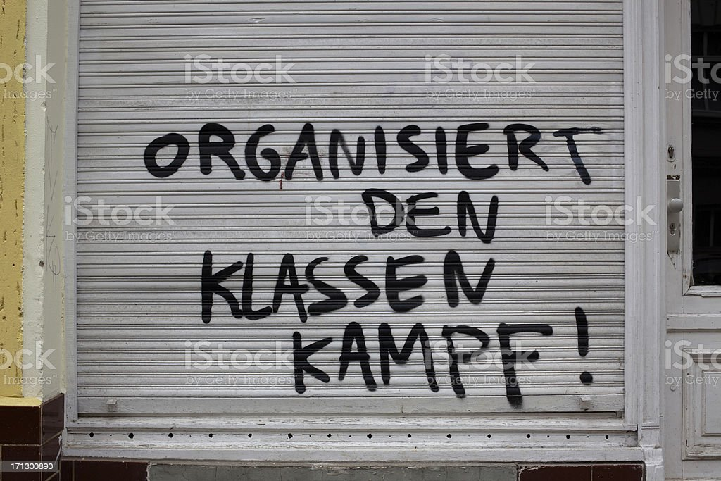 graffiti which is calling for organising the class struggle royalty-free stock photo