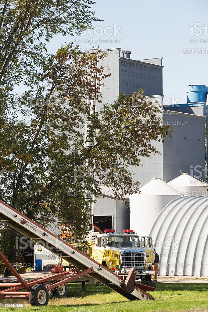 Grain Auger and Fire Engine Ladder Truck at Grain Elevator stock photo