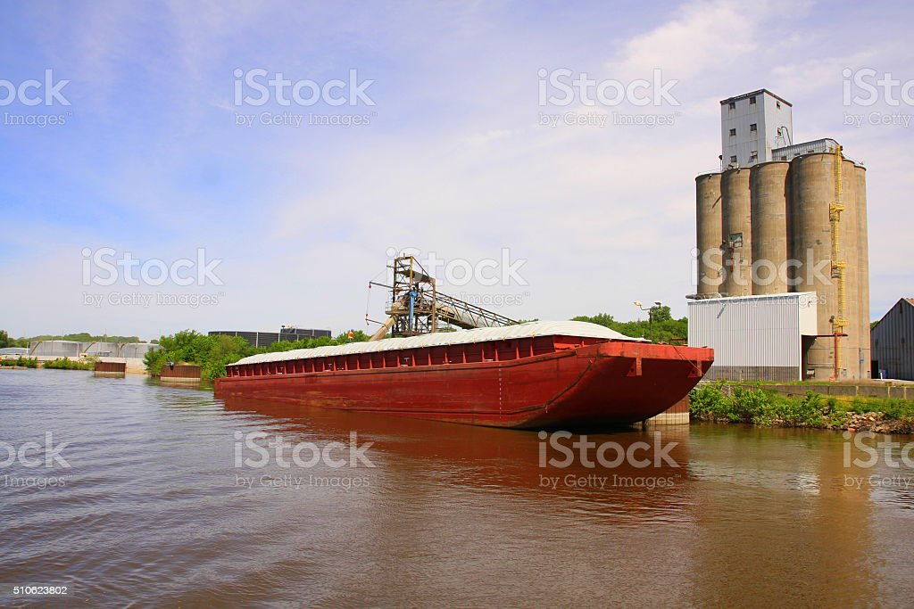 Grain Barge on Mississippi River stock photo