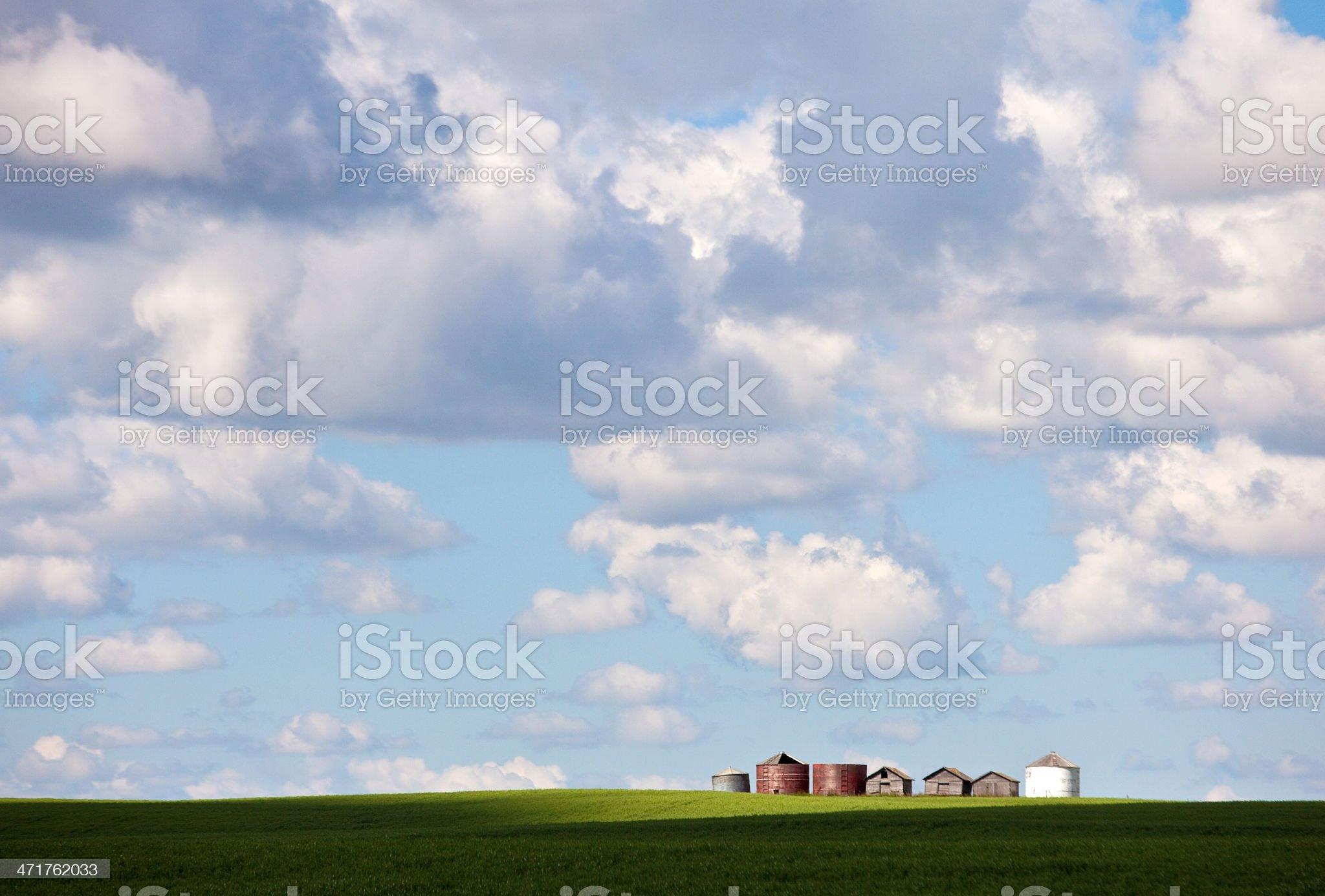 Grain Bins and Prairie Sky royalty-free stock photo