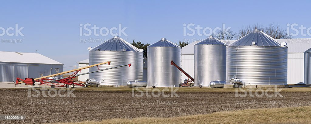 Grain bins on a farm stock photo