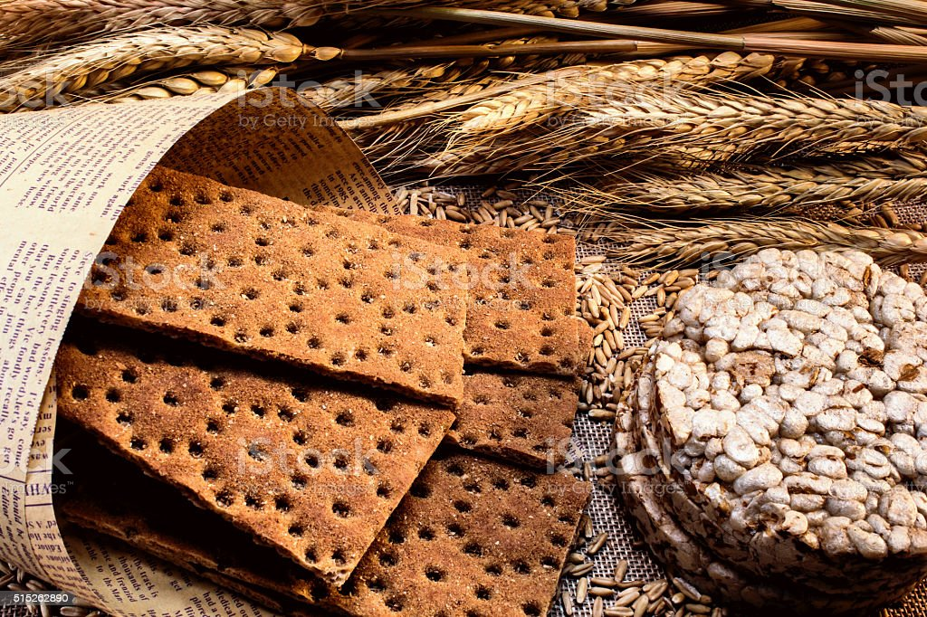 grain crackers in a paper bag, grains of wheat, wheat ears stock photo