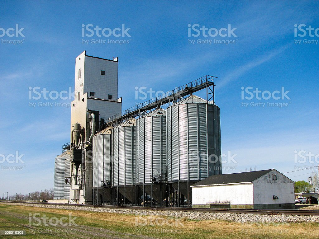 Grain Elevator and Bins with Blue Sky stock photo