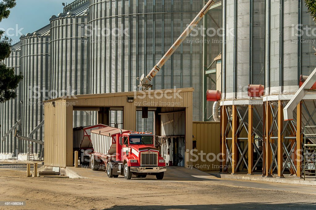 Grain Elevator and Truck, Central Valley, California stock photo