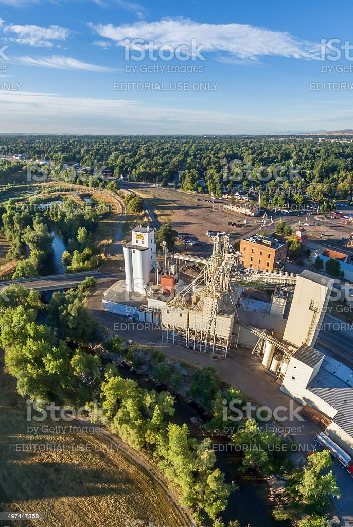 grain elevators and mill aerial view stock photo