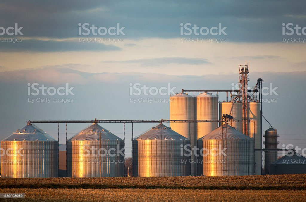 Grain Elevators in The Midwest With Sunset Reflection. stock photo