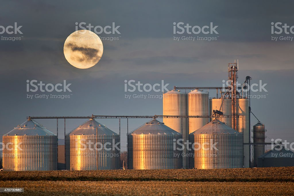Grain Elevators With Full Moon in Rural Midwest Landscape. stock photo