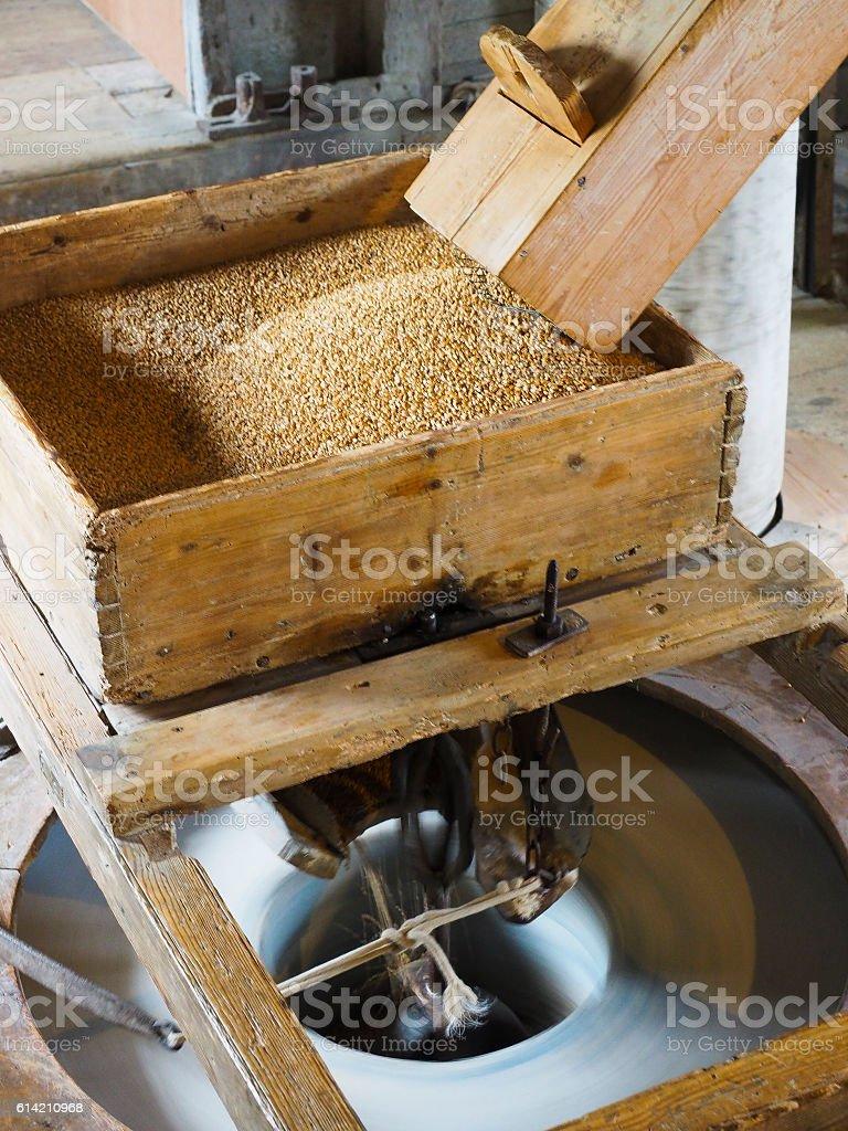 Grain hopper for stone grinding bread flour stock photo