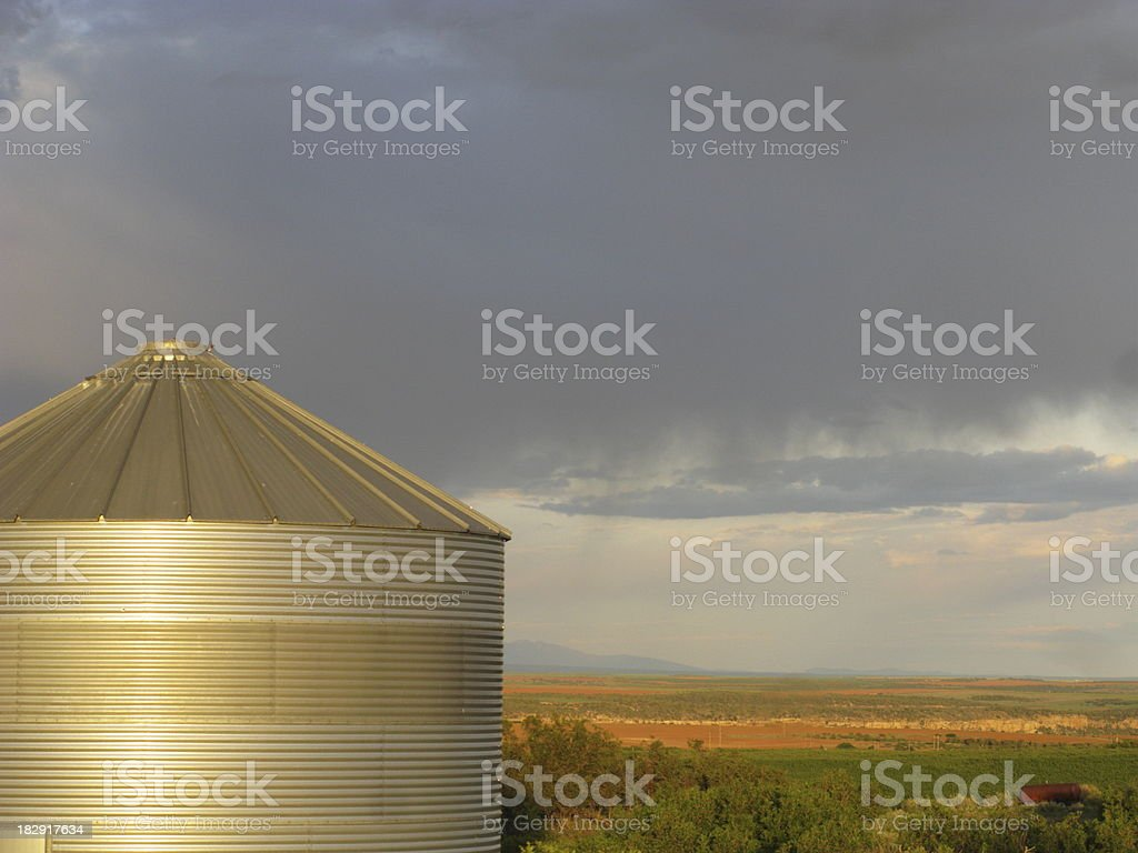 Grain Silo Storm Clouds Farm royalty-free stock photo