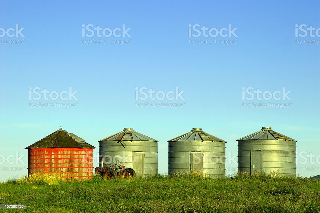Grain Silos and a tractor stock photo