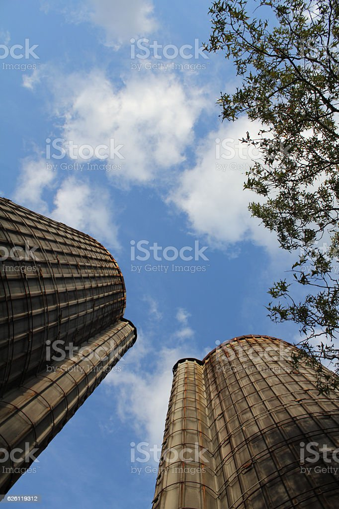 Grain Silos with View from Bottom of Blue Sky stock photo