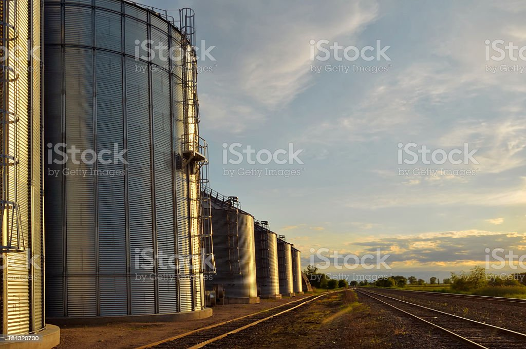 Grain Storage And Railroad Tracks royalty-free stock photo