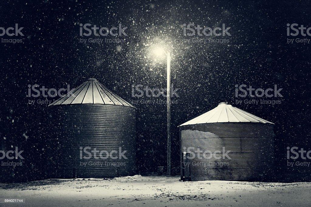 Grain Storage Bins In Winter Snow Storm stock photo