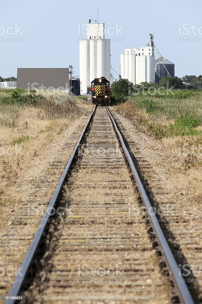 Grain train loading at elevator/silo royalty-free stock photo