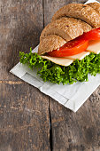 grain vegetarian croissant sandwich on a wooden background old